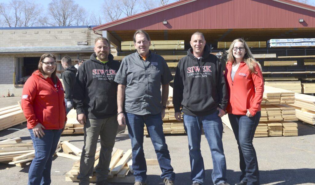 Siwek Lumber team standing in front of Jordan location